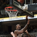 Missouri's Alex Oriakhi, center, shoots over Georgia's Kenny Gaines, left, and Kentavious Caldwell-Pope, right, during the first half of an NCAA college basketball game, Wednesday, Jan. 16, 2013, in Columbia, Mo. (AP Photo/L.G. Patterson)