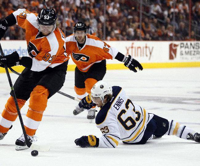 Philadelphia Flyers' Jakub Voracek, left, takes the puck away from a falling Buffalo Sabres' Tyler Ennis, right, during the third period of an NHL hockey game, Sunday, April 6, 2014, in Philadelphia. The Flyers won 5-2