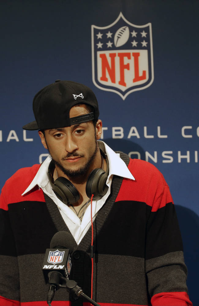 San Francisco 49ers quarterback Colin Kaepernick speaks during a news conference after the NFL football NFC Championship game against the Seattle Seahawks, Sunday, Jan. 19, 2014, in Seattle. The Seahawks won 23-17 to advance to Super Bowl XLVIII