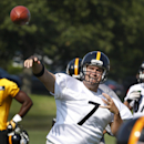 Pittsburgh Steelers quarterback Ben Roethlisberger (7) passes to wide receiver Antonio Brown, lower right, during the first practice of the NFL football team's training camp in Latrobe, Pa., on Saturday, July 26, 2014 The Associated Press