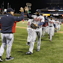 Atlanta Braves right fielder Jason Heyward, center, celebrates with teammates after a baseball game against the Philadelphia Phillies, Wednesday, April 16, 2014, in Philadelphia. Atlanta won 1-0 The Associated Press