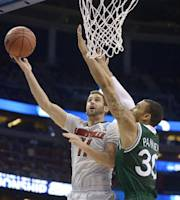 Louisville forward Luke Hancock (11) aims for the basket as Manhattan forward Ashton Pankey (30) defends during the first half in a second-round game in the NCAA college basketball tournament Thursday, March 20, 2014, in Orlando, Fla. (AP Photo/Phelan M. Ebenhack)