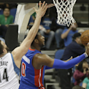 Detroit Pistons' Andre Drummond, right, attempts a layup as Minnesota Timberwolves' Nikola Pekovic, left, of Montenegro, defends in the first quarter of an NBA basketball game, Friday, March 7, 2014, in Minneapolis The Associated Press