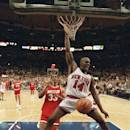 FILE - In this June 17, 1994 New York Knicks forward Anthony Mason (14) dunks the ball ahead of Houston Rockets forward Otis Thorpe (33) during the fourth quarter of game five of the NBA Finals in New York. The New York Knicks spokesman Jonathan Supranowitz confirmed Saturday, Feb. 28, 2015 that Mason, a rugged power forward who was a defensive force for several NBA teams in the 1990s, has died. He was 48. (AP Photo/Amy Sancetta)