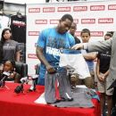 Philadelphia Eagles quarterback Michael Vick shows and discusses his new V7 apparel line at Modell's Sporting Goods, Wednesday, July 11, 2012, in Philadelphia. The clothing line called V7 and will be sold exclusively at East Coast sporting goods shop Modell's. (AP Photo/Brynn Anderson)