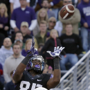 TCU wide receiver LaDarius Brown (85) catches a touchdown pass against Baylor safety Orion Stewart (28) during the first half of an NCAA college football game on Saturday, Nov. 30, 2013, in Fort Worth, Texas The Associated Press