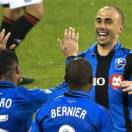 Montreal Impact's Marco Di Vaio, right, celebrates with teammates Andres Romero and Patrice Bernier after scoring against the Philadelphia Union during first half MLS soccer matcth in Montreal, Saturday, May 25, 2013. (AP Photo/The Canadian Press, Graham Hughes)