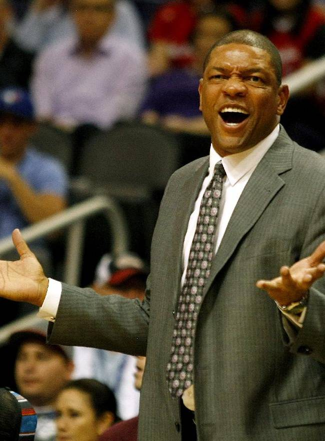 Los Angeles Clippers head coach Doc Rivers reacts to a call in the first quarter of an NBA preseason basketball game against the Phoenix Suns on Tuesday, Oct. 15, 2013, in Phoenix