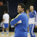 UCLA head coach Steve Alford watches his team work out during practice at the NCAA college basketball tournament, Wednesday, March 26, 2014, in Memphis, Tenn. UCLA plays Florida in a regional semifinal on Thursday. (AP Photo/John Bazemore)