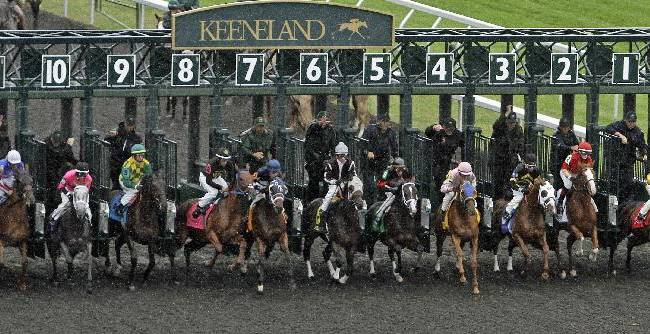 Thoroughbreds break from the gate to start the Bourbon Stakes horse race, moved from the turf to the main track because of heavy rain, at Keeneland Race Course in Lexington, Ky., Sunday, Oct. 6,  2013. Poker Player (10) ran down Bashart (5) and Bon Accord (8) in the final furlong to capture the Breeders' Cup juvenile turf