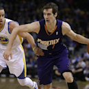 Phoenix Suns' Goran Dragic, right, drives the ball past Golden State Warriors' Stephen Curry (30) during the first half of an NBA basketball game Sunday, March 9, 2014, in Oakland, Calif The Associated Press