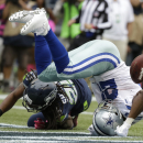 Murray leads Dallas past Seattle 30-23 The Associated Press