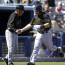 Pittsburgh Pirates catcher Russell Martin is greeted by third base coach Nick Leyva after hitting a three-run homer off Tampa Bay Rays relief pitcher Grant Balfour in the fourth inning of a exhibition baseball game in Port Charlotte, Fla., Saturday, March