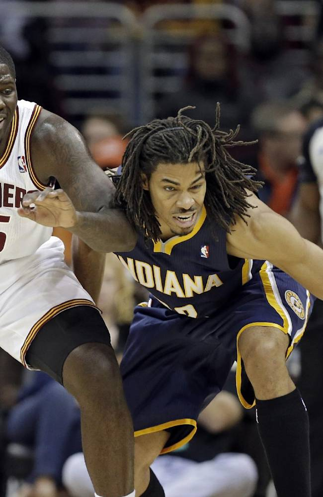 Indiana Pacers' Chris Copeland, right, defends against Cleveland Cavaliers' Anthony Bennett (15) in the second quarter of a preseason NBA basketball game Saturday, Oct. 19, 2013, in Cleveland