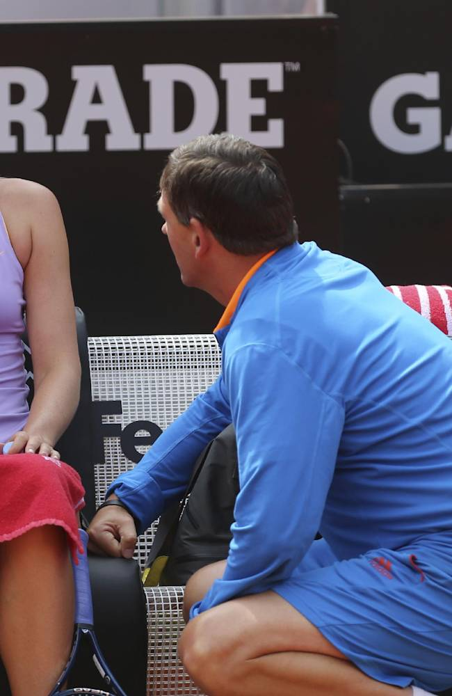Russia's Maria Sharapova listens to her coach Sven Groeneveld during her match against Serbia's Ana Ivanovic at the Italian open tennis tournament in Rome, Thursday, May 15, 2014