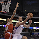 Los Angeles Clippers forward Hedo Turkoglu, right, of Turkey, puts up a shot as Milwaukee Bucks guard Giannis Antetokounmpo, of Greece, defends during the first half of an NBA basketball game, Monday, March 24, 2014, in Los Angeles The Associated Press