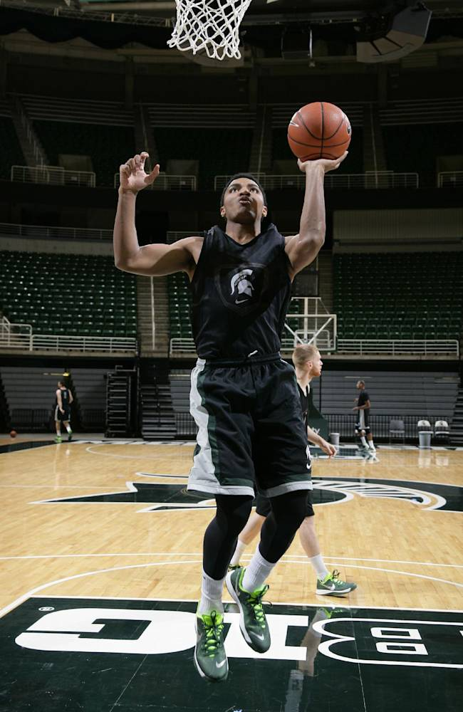 Michigan State's Gary Harris warms up for a practice following the team's NCAA college basketball media day, Tuesday, Oct. 22, 2013, in East Lansing, Mich