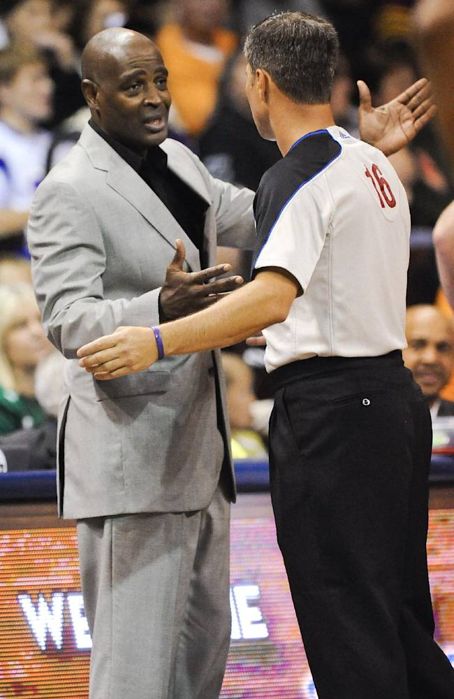 ADDS THAT IT IS A PRESEASON GAME - Milwaukee Bucks head coach Larry Drew, left, talks to an official during their Thursday Oct 10, 2013, NBA preseason basketball game against the Minnesota Timberwolves in Sioux Falls, S.D