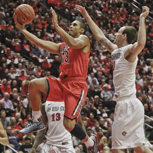 Arizona guard Nick Johnson blows past San Diego State forward Matt Shrigley while scoring during the second half of Arizona's 69-60 victory in a NCAA college basketball game Thursday, Nov. 14, 2013, in San Diego