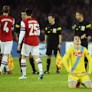 Napoli's Jose Callejon, foreground right, reacts at the end of a Champions League, group F, soccer match between Napoli and Arsenal, at the Naples San Paolo stadium, Italy, Wednesday, Dec. 11, 2013. Ten-man Arsenal advanced to the Champions League knockou