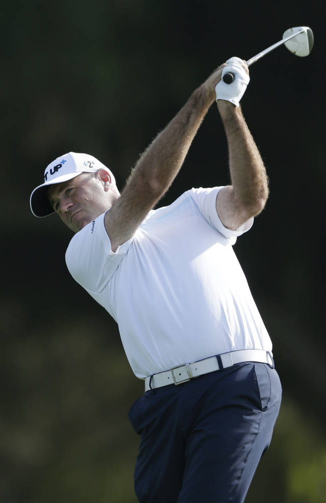 Stewart Cink hits his tee shot on the 15th hole of the north course during the first round of the Farmers Insurance Open golf tournament Thursday, Jan. 23, 2014, in San Diego
