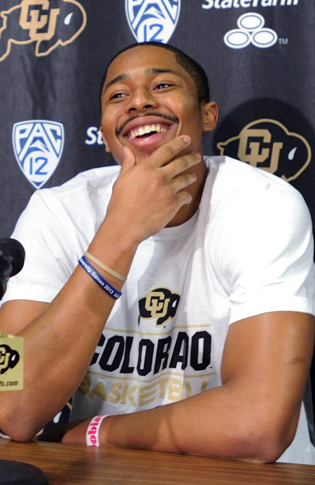 Colorado junior point guard Spencer Dinwiddie announces that he will skip his senior season and declare for the NFL basketball draft, Thursday, April 24, 2014, in Boulder, Colo