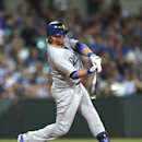 The Los Angeles Dodgers' Justin Turner singles into center in the top of the fifth inning during the Major League Baseball opening game between the Los Angeles Dodgers and Arizona Diamondbacks at the Sydney Cricket ground in Sydney, Saturday, March 22, 20