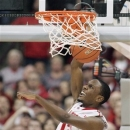 Ohio State's Sam Thompson (12) dunks against Michigan during the second half of an NCAA college basketball game Sunday, Jan. 13, 2013, in Columbus, Ohio. Ohio State won 56-53. (AP Photo/Mike Munden)