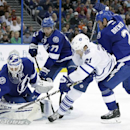 Tampa Bay Lightning goalie Anders Lindback (39), of Sweden, makes a save on a shot by Toronto Maple Leafs left wing James van Riemsdyk (21) as Lightning defensemen Victor Hedman (77), of Sweden, defenseman Eric Brewer (2) look on during the third period o