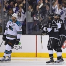 Los Angeles Kings defenseman Slava Voynov (26) is congratulated by right wing Justin Williams (14) as San Jose Sharks center