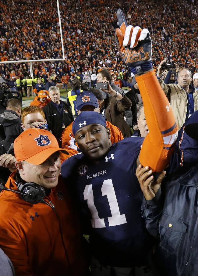In this Nov. 30, 2013, file photo, Auburn cornerback Chris Davis (11) reacts after returning a missed field goal attempt 109 yards to score the game-winning touchdown as time expired an NCAA college football game against Alabama in Auburn, Ala. Davis and Dee Ford were much like their Auburn team early in the season, largely floating under the radar. The two defensive players garnered much more attention as the Tigers had success and are trying to forge NFL careers starting with the Senior Bowl