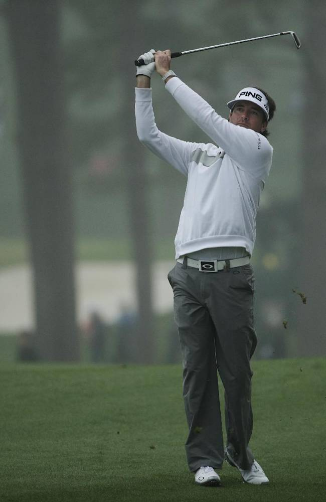 Bubba Watson watches his shot on the 17th fairway during a practice session for the Masters golf tournament Monday, April 7, 2014, in Augusta, Ga