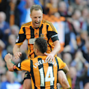 Hull City's David Meyler, top, celebrates with teammate Jake Livermore after scoring against Sheffield United during their English FA Cup semifinal soccer match between Hull City and Sheffield United at Wembley Stadium, London, England, Sunday, April 13,
