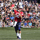 New England Patriots quarterback Tom Brady throws during an NFL football training camp in Foxborough, Mass., Friday, July 25, 2014 The Associated Press