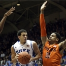Duke's Seth Curry drives between Virginia Tech's Robert Brown, left, and Jarell Eddie during the first half of an NCAA college basketball game in Durham, N.C., Tuesday, March 5, 2013. (AP Photo/Gerry Broome)