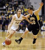 Albany's Lindsey Lowrie (10) drives past UMBC's Michelle Kurowski (20) during an NCAA college basketball game in the women's America East Conference tournament championship, Saturday, March 10, 2012, in Albany, N.Y. (AP Photo/Tim Roske)