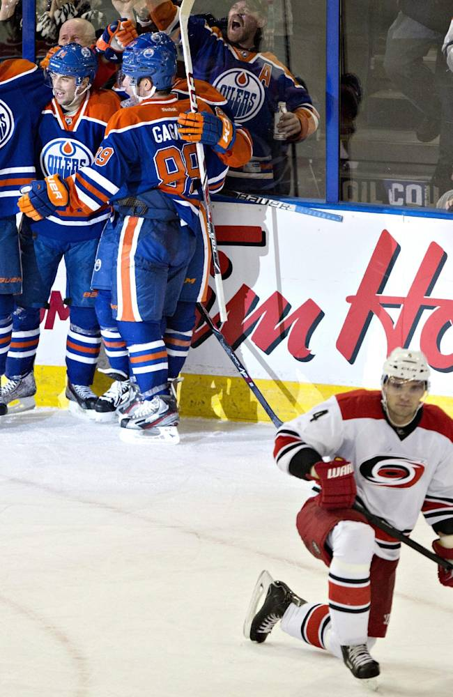 Oilers slip past Hurricanes 5-4 in OT