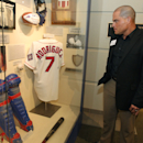 Former Texas Rangers catcher Ivan Rodriguez looks over a display with some of his memorabilia as he is inducted into the Texas Sports Hall Of Fame, Thursday, Feb. 27, 2014, in Waco, Texas The Associated Press