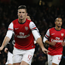 Arsenal s Olivier Giroud, left, celebrates scoring a penalty and his second goal of the game beside Theo Walcott, right, during the English Premier League soccer match between Arsenal and Southampton at the Emirates Stadium in London, Saturday, Nov. 23, 2