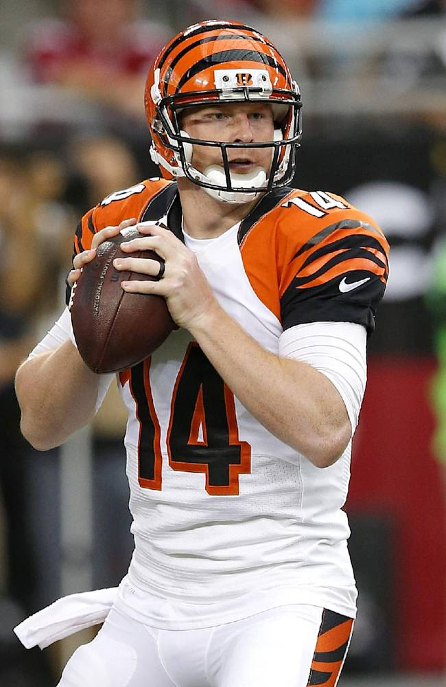 Cincinnati Bengals quarterback Andy Dalton (14) looks to pass against the Arizona Cardinals during the first half of an NFL preseason football game, Sunday, Aug. 24, 2014, in Glendale, Ariz