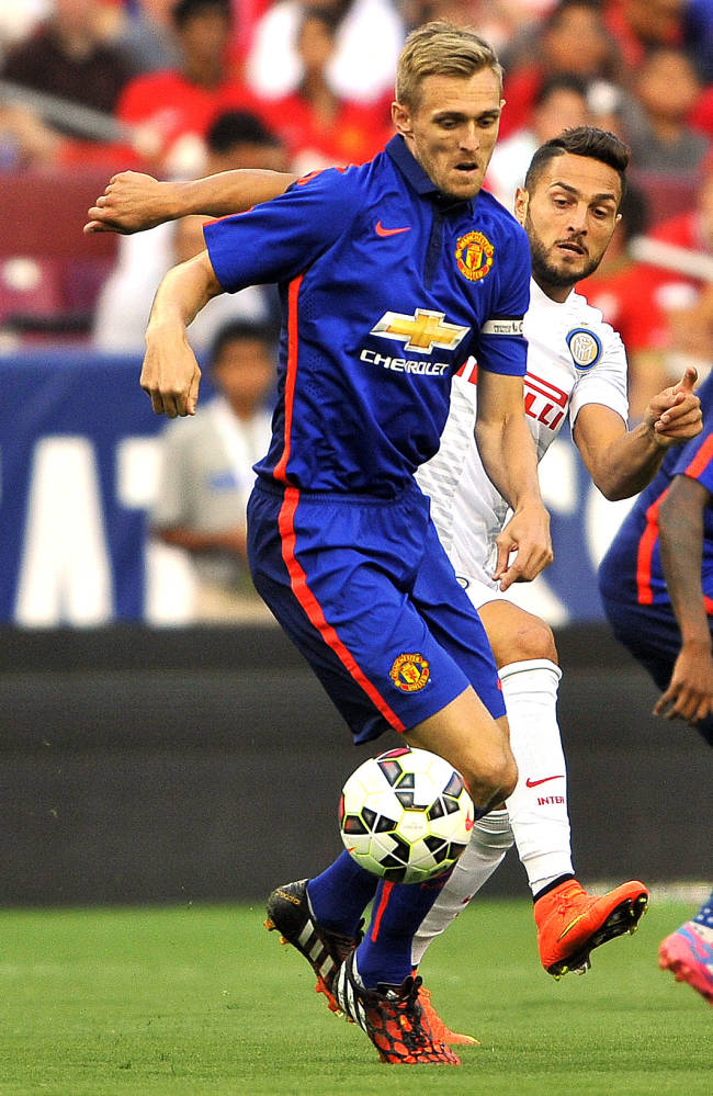 IMAGE DISTRIBUTED FOR GUINNESS INTERNATIONAL CHAMPIONS CUP - Manchester United midfielder Darren Fletcher (24) moves the ball down the field during a match between Inter Milan and Manchester United in the 2014 Guinness International Champions Cup on Tuesday, July 29, 2014 in Landover, Maryland. (Larry French/AP Images for Guinness International Champions Cup)