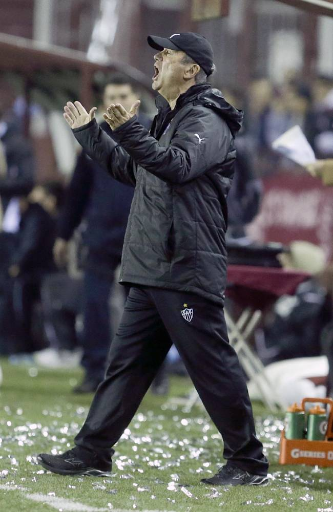 Levir Culpi, coach of Brazil's Altetico Mineiro, gestures during the Recopa Sudamericana first leg soccer match between Argentina's Lanus and Brazil's Altetico Mineiro in Buenos Aires, Argentina,  Wednesday, July 16, 2014
