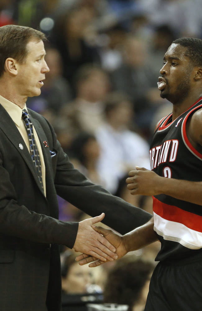 Portland Trail Blazers head coach Terry Stotts greets guard Wesley Matthews as he comes off the court during the fourth quarter of an NBA basketball game against the Sacramento Kings in Sacramento, Calif., Saturday, Nov. 9, 2013.  The Trail Blazers won 96-85