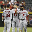 Washington Nationals' Denard Span (2) is congratulated by teammates Chad Tracy (18) and Ryan Zimmerman following a 2-0 victory over the Arizona Diamondbacks in a baseball game, Saturday, Sept. 28, 2013, in Phoenix The Associated Press