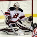 Jeremy Brodeur, son of New Jersey Devils goalkeeper Martin Brodeur, deflects a shot by Darcy Murphy during the Devils' rookies NHL hockey camp,, Tuesday, July 15, 2014, in Newark, N.J The Associated Press