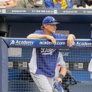 Los Angeles Dodgers manager Don Mattingly looks on during a  baseball game against the Atlanta Braves Sunday, May 19, 2013, in Atlanta. (AP Photo/Todd Kirkland)