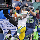 Green Bay Packers' Sam Shields intercepts a pass in front of Seattle Seahawks' Jermaine Kearsen during the first half of the NFL football NFC Championship game Sunday, Jan. 18, 2015, in Seattle The Associated Press