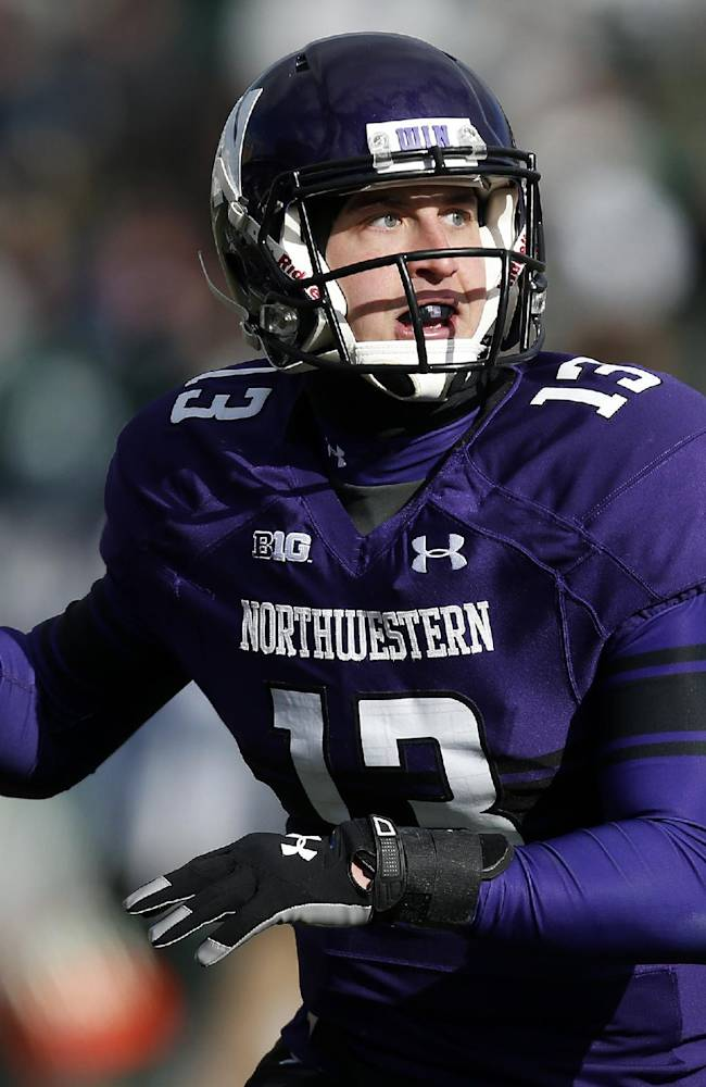 Northwestern quarterback Trevor Siemian (13) sets up for a pass against Michigan State during the first half of an NCAA college football game on Saturday, Nov. 23, 2013, in Evanston, Ill
