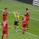 Dortmund's Jakub Blaszczykowski of Poland, center, reacts after failing to score past Bayern goalkeeper Manuel Neuer, right, during the Champions League Final soccer match between  Borussia Dortmund and Bayern Munich at Wembley Stadium in London, Saturday May 25, 2013. (AP Photo/Alastair Grant)