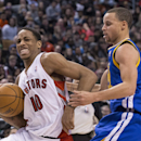Toronto Raptors' DeMar DeRozan, left, drives past Golden State Warriors' Stephen Curry during the second half of an NBA basketball game in Toronto on Sunday, March 2, 2014. (AP photo/The Canadian Press, Chris Young) The Associated Press